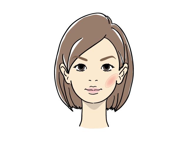 頬骨の下あたりに、やや斜めの楕円形のチークが入った女性